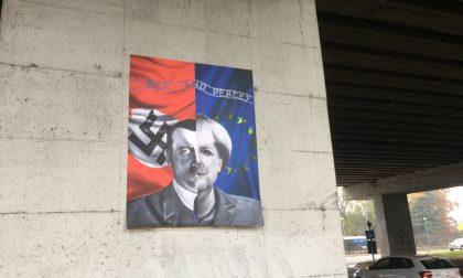 Hitler-Merkel (con tanto di svastica) sotto il ponte della tangenziale
